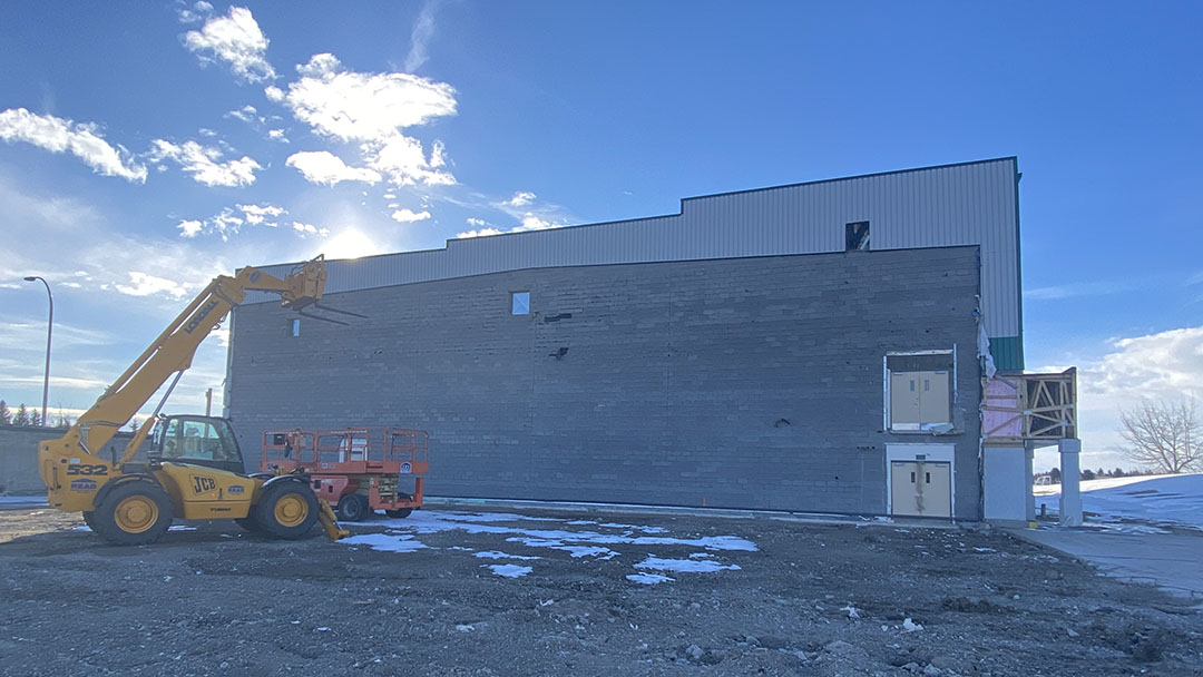 Refinishing the exterior of the Camrose Field House